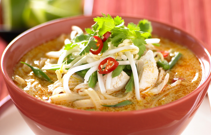 Cooking chicken laksa